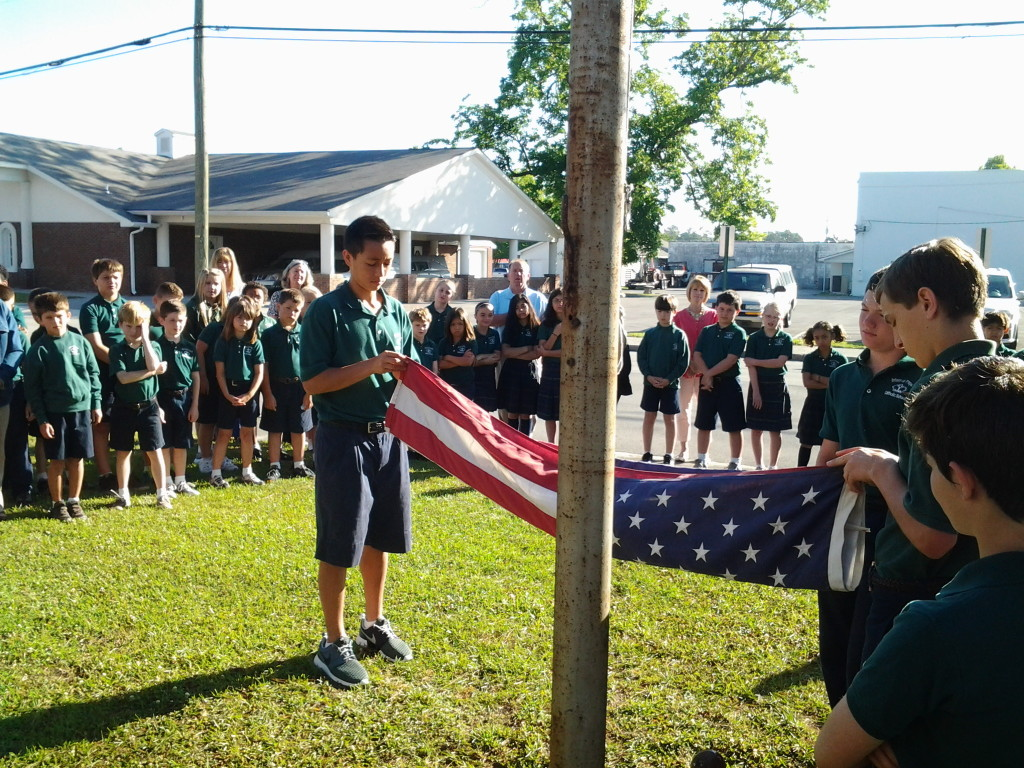 Flag Ceremony at Infant of Prague School on 2 June 2014. Out-going eighth grade class passing colors to incoming eighth graders.