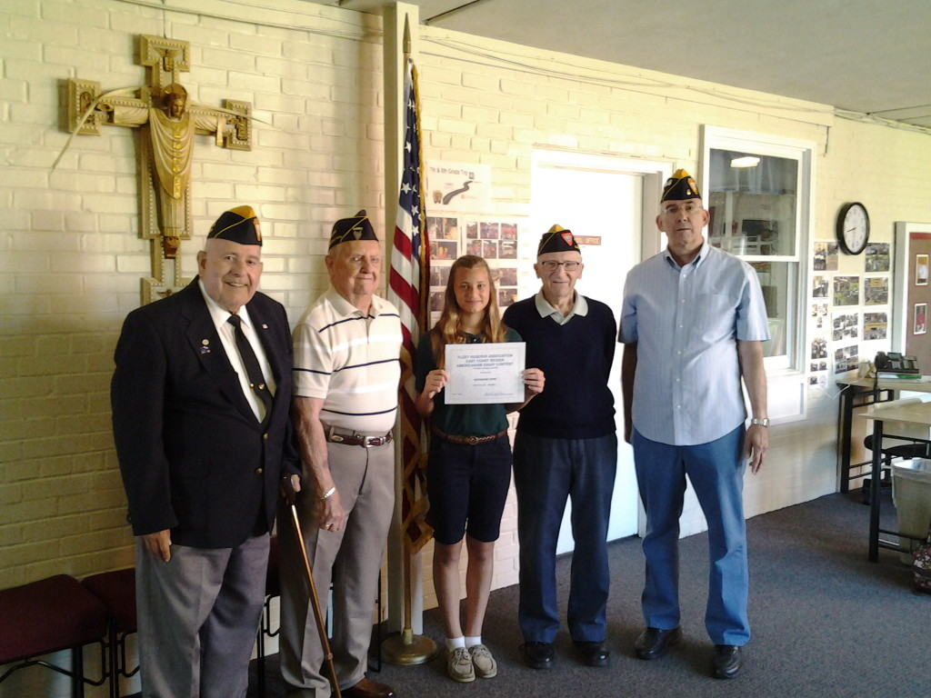 Seventh grade Regional essay contest winner Katherine Dyke with S/M's Broussard, Hemmingway, Baum and Rogers at Infant of Prague on 2 June 2014.