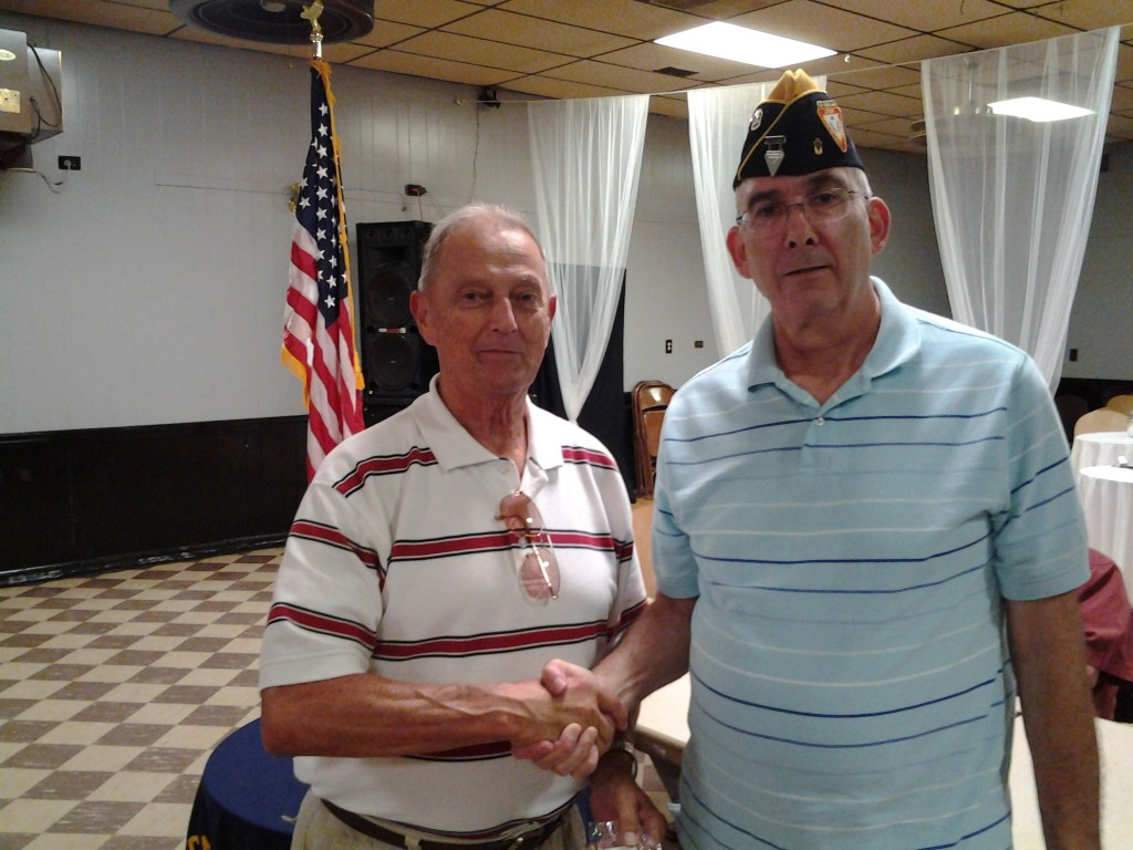 Shipmate Rothermel receiving his 30 continuous membership pin from Shipmate Rogers on 12 August 2014