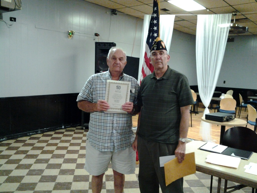 Shipmate William Spencer receiving his 50 year continuous membership award from Shipmate Mark Rogers on 9 September 2014