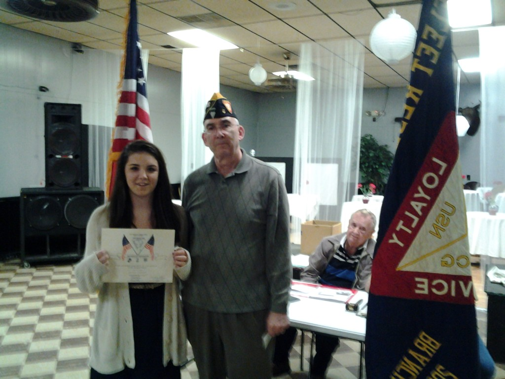 FIRST PLACE SEVENTH GRADE AMERICANISM ESSAY CONTEST WINNER MADISYN HICKMAN RECEIVING AWARD FROM S/M ROGERS ON 10 MARCH 2015
