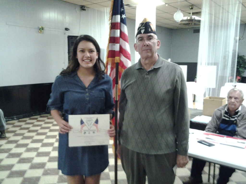 FIRST PLACE TWELFTH GRADE AMERICANISM ESSAY CONTEST WINNER MARINA VICTORIA ROBLES RECEIVING AWARD FROM S/M ROGERS ON 10 MARCH 2015