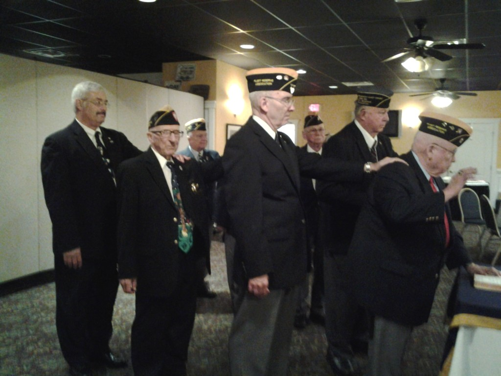 OFFICERS PAUL MIETHKER, BOB BAUM, PAUL SIVERSON, MARK ROGERS, GEORGE BARROWS, EARL HARPER (STANDING IN FOR GEORGE CLEVELAND) AND BILL BOGGS BEING INSTALLED AT THE JOINT INSTALLATION ON 9 JUNE 2015