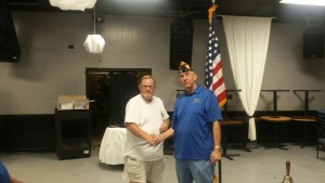 SHIPMATE ROBEN SMITH RECEIVING HIS 20 YEAR CONTINUOUS MEMBERSHIP PIN FROM SHIPMATE MARK ROGERS ON 12 JULY 2016