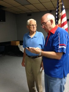 Shipmate George Liset receiving his 45 year continuous membership pin in the FRA from Shipmate Mark Rogers at the monthly meeting on 1 4 July 2015