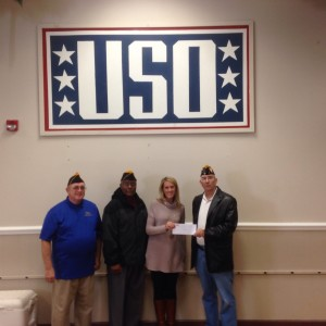 (L-R) SHIPMATE'S BLIZARD AND APPLEWHITE, AMY LEUSCHKE OF THE USO AND SHIPMATE ROGERS PRESENT A CHECK FOR $300.00 ON 9 DECEMBER