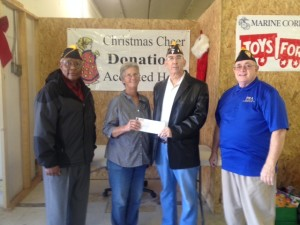 (l-r) SHIPMATE APPLEWHITE, LINDA FOUNTAIN OF CHRISTMAS CHEER, AND SHIPMATE'S ROGERS AND BLIZARD PRESENT A CHECK FOR $300.00 ON 9 DECEMBER